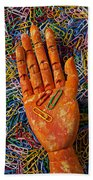 Orange Wooden Hand Holding Paperclips Beach Towel