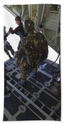 Paratroopers Jump From A C-130 Hercules Beach Towel by Andrew Chittock