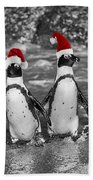 Penguins With Santa Claus Caps Beach Towel