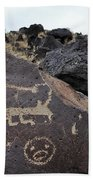 Petroglyph Monument Animal Beach Towel by Kyle Hanson