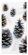 Pine Cones Looking Like Christmas Trees On White Snowy Backgroun Beach Towel