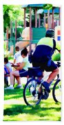 Police Officer Rides A Bicycle Beach Towel