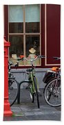Postbox And Bicycles In Front Of The Diamond Museum In Bruges Beach Towel