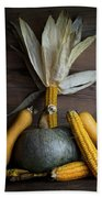 Pumpkin, Corncob, Autumn Leaves And Burning Candles Decoration O Beach Towel