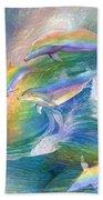 Rainbow Dolphins Beach Towel