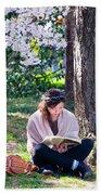 Reading Beneath The Cherry Blossoms Beach Towel