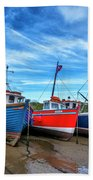Red And Blue Fishing Boats Tenby Port Beach Towel