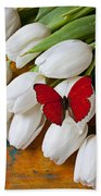 Red Butterfly On White Tulips Beach Towel by Garry Gay