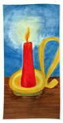 Red Candle Lighting Up The Dark Blue Night. Beach Towel
