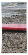 Red Surf Board On A Rocky Beach Beach Towel