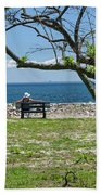 Relaxing By The Shore Beach Towel