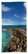 Rocky Shoreline On The Beach At Atlantis Resort Beach Towel