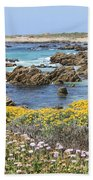Rocky Surf With Wildflowers Beach Towel