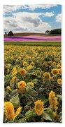 Rolling Hills Of Flowers In Summer Beach Towel