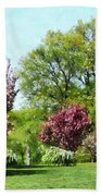 Row Of Flowering Trees Beach Towel