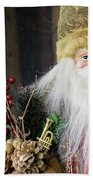 Santa Claus Doll In Green Suit With Forest Background. Beach Towel