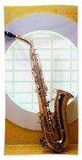 Saxophone In Round Window Beach Towel
