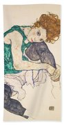 Seated Woman With Legs Drawn Up Beach Sheet
