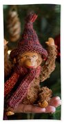 Silly Old Monkey Toy In A Child Hands Under The Christmas Tree Beach Towel