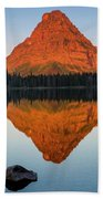 Sinopah Mountain Reflected In Two Medicine Lake At Sunrise Beach Towel