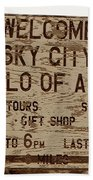 Sky City Sign Beach Towel