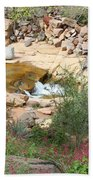 Slide Rock With Pink Wildflowers Beach Sheet