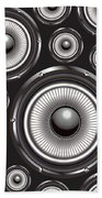 Speakers Over Black Beach Towel