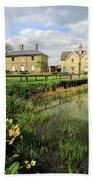 Spring Daffodils, Ramsey Village Pond, Cambridgeshire, England Beach Towel