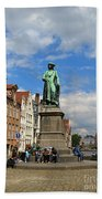 Statue Of Jan Van Eyck Beside The Spieglerei Canal In Bruges Beach Towel
