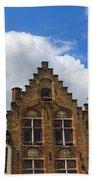 Stepped Gables Of The Brick Houses In Jan Van Eyck Square Beach Towel