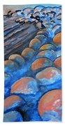 Stones By The Sea Beach Towel