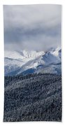 Storm Clouds Receding And Fresh Snow On Pikes Peak Beach Towel