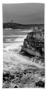 stormy sea - Slow waves in a rocky coast black and white photo by pedro cardona Beach Towel