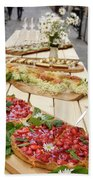 Strawberry Cake And Other Snacks On A Wood Table Outdoors On Sta Beach Towel
