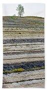 Striped Bank On Side Of A Road In Northwest North Dakota Beach Towel
