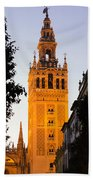 Sunset In Seville - A View Of The Giralda Beach Towel