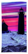 Sunset In Winter At Grand Haven Lighthouse Beach Towel