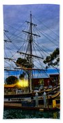 Sunset Over A Tall Ship Beach Towel