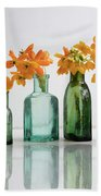 the Blooming yellow Ornithogalum Dubium in a transparent bottle instead vase Beach Towel