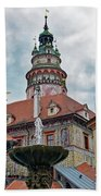 The Cesky Krumlov Castle Tower With A Fountain Below Within The Czech Republic Beach Towel