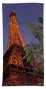 The Eiffel Tower Aglow Beach Towel