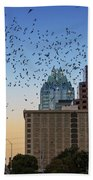 The Frost Bank Tower Stands Guard As 1.5 Million Mexican Free-tail Bats Overtake The Austin Skyline As They Exit The Congress Avenue Bridge Beach Towel