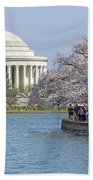 The Jefferson Memorial With Cherry Blossoms And A Lot Of People Beach Towel