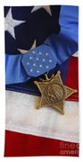 The Medal Of Honor Rests On A Flag Beach Sheet