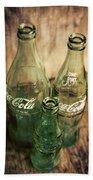 Three Vintage Coca Cola Bottles  Beach Towel