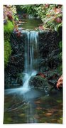 Tiny Waterfall In Japanese  Garden.the Butchart Gardens,victoria.canada. Beach Towel