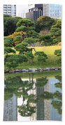 Tokyo Trees Reflection Beach Towel by Carol Groenen
