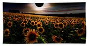 Total Eclipse Over The Sunflower Field Beach Towel