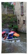 Tourists With Umbrellas In A Sightseeing Boat On The Canal In Bruges Beach Towel