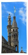 Towers Of The Town Hall In Bruges Belgium Beach Towel
